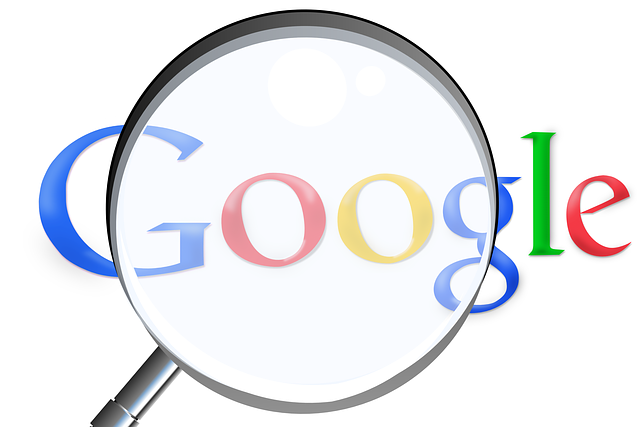 Google magnifying glass showing searches through Google web